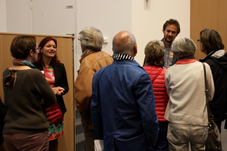 Project coordinator Dr Gaël Chételat (second from left) and Dr Antoine Lutz (third from right) chat with potential clinical trial volunteers at one of the Project's public meetings in Caen, France.
